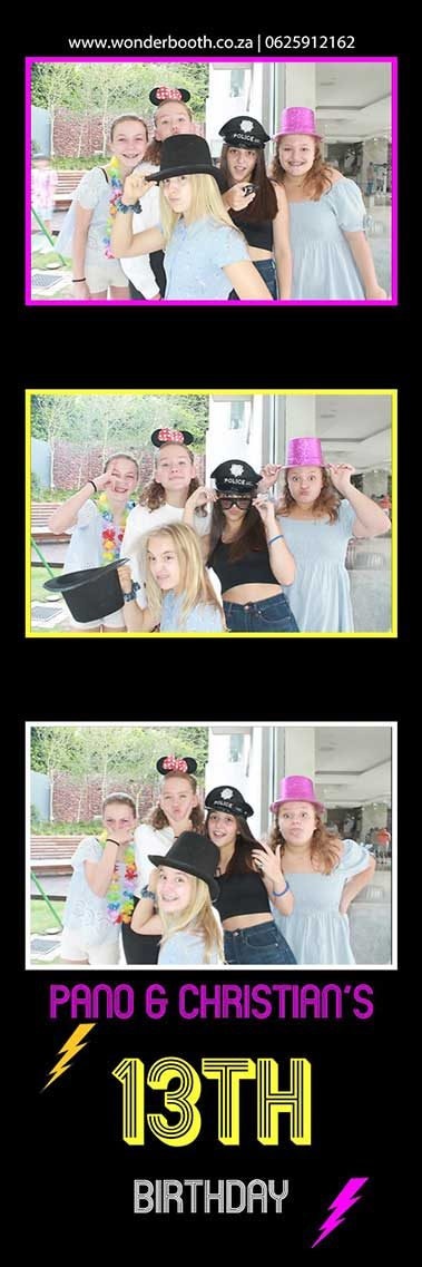 Photo booth fun of three young girls with props