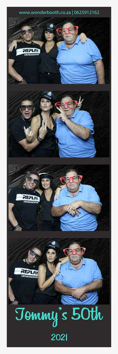 Greenscreen photo booth strip at Tommy's 50th